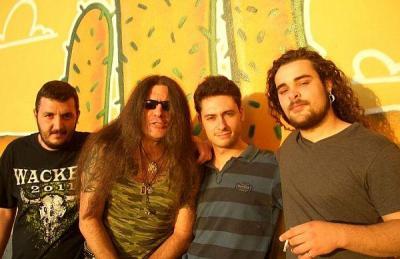"""Рокаджията с пловдивски корен (вторият отляво) жъне успехи с италианската си банда.  Снимка агенция """"Темпо Нюз"""""""